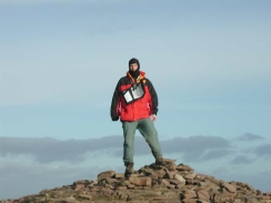 PC280295	Myself standing on the cairn at the top of Pen y Fan.