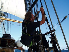 P20089215392	Neil painting some of the rigging.
