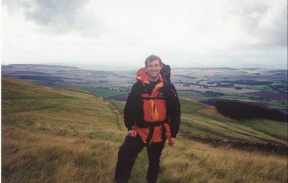 R14	Myself on the descent from Wideopen Hill. In the background is the ground that I would walk over in the next two days.